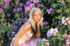 Girl with rhododendron Royalty Free Stock Photography