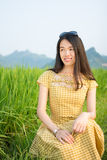 Girl in the rice field with karst scenery Stock Photo