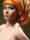 Girl with a rich turban Royalty Free Stock Photography