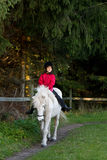 Girl ridding a horse Royalty Free Stock Image