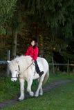 Girl ridding a horse Stock Photography