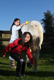 Girl ridding a white horse in denmark Royalty Free Stock Photography