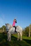 Girl ridding a white horse in denmark Stock Photos