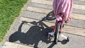 Girl ride a bicycle in the park stock video