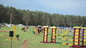 Girl ride horse. Blond girl ride horse in horserace steeplechase competition on June 01, 2013 in Niuronys, Lithuania stock video footage