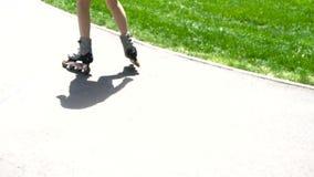 Girl ride on roller skates stock footage