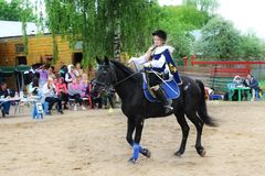 Girl rider in the form of binding performs Musketeers competition program. Royalty Free Stock Images