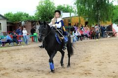 Girl rider in the form of binding performs Musketeers competition program. Stock Images