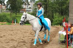 Girl rider in front of the jury. Amateur competitions on dressage horses. Russia, Moscow region, Shchelkovo district. Informal competitions among local people stock images