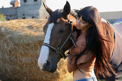 The girl rider. Walking his horse Royalty Free Stock Photography