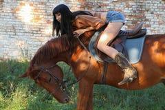 The girl rider. Walking his horse Royalty Free Stock Photos