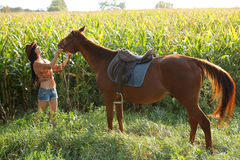 The girl rider. Walking his horse Stock Images