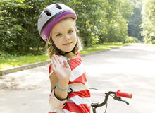 Girl rides a bicycle in a park Stock Photos