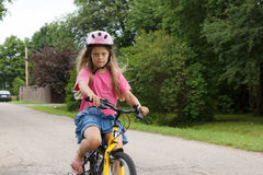 Girl rides a bicycle Royalty Free Stock Image