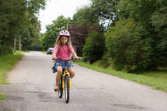 Girl rides a bicycle Royalty Free Stock Photo