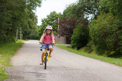 Girl rides a bicycle Stock Photography