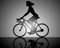 Girl rides on bike Stock Photography