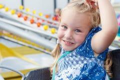 A girl rides carousel Stock Photo