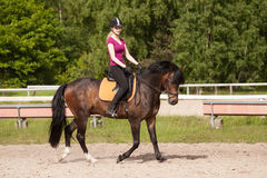 Girl rides her horse Stock Photo