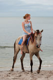 Girl rides on horse Royalty Free Stock Image