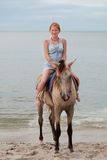 Girl rides on horse royalty free stock images