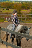 Girl rides a horse Stock Photo