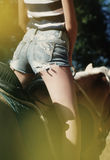Young girl hips on the horse Stock Image