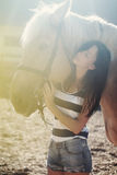 Beautiful girl rides a horse Royalty Free Stock Photo