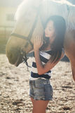 Beautiful girl rides a horse Stock Photo