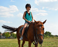 Girl rides on a horse Stock Photos