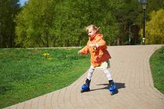 Girl rides on roller skates Royalty Free Stock Photo