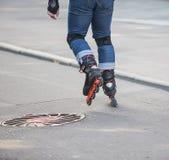 Girl rides on roller skates Stock Photos