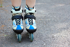 Girl rides on roller skates Royalty Free Stock Photo