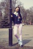 Girl rides on roller skates. Stock Photo