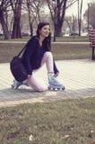 Girl rides on roller skates in the park. Stock Image