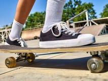 Girl rides on roller skates in skatepark. Royalty Free Stock Image