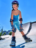 Girl rides on roller skates in skatepark. Royalty Free Stock Photos