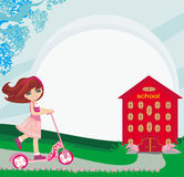 Girl rides a scooter near school Royalty Free Stock Photos