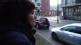Girl rides a tram to Amsterdam and looks out the window.  stock footage