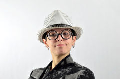 Girl with ridiculous expression, hat and glasses Stock Photo