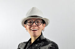 Girl with ridiculous expression, hat and glasses Royalty Free Stock Image
