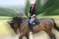 Girl riding. Blurred Royalty Free Stock Photography