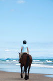 Girl riding at beach Royalty Free Stock Image