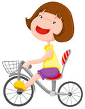 Girl riding a bicycle Royalty Free Stock Photo