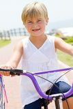 Girl riding bicycle Royalty Free Stock Photography