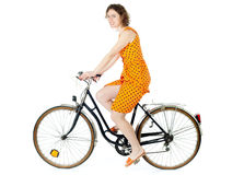 Girl riding bicycle Stock Photos