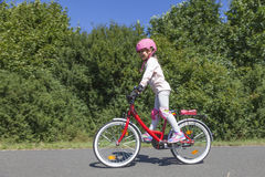 Girl riding bicycle Royalty Free Stock Image