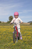 Girl riding bicycle Royalty Free Stock Photos