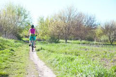 The girl is riding a bicycle. Royalty Free Stock Photos