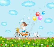 Girl riding bicycle and dog running in a good day Stock Photography
